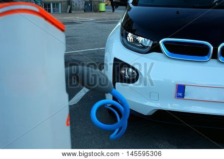 Hybrid car electric charger station in the Car Parking