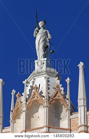 VENICE ITALY - DECEMBER 19 2012. Marble Lady Justicia at Palazzo Ducale Sculpture in Venice Italy.