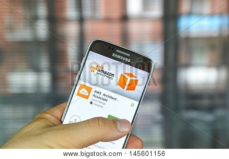 MONTREAL CANADA - August 8 2016 - AWS mobile app on screen of Samsung S7 in hand. Amazon AWS offers a suite of cloud-computing services that make up an on-demand computing platform.