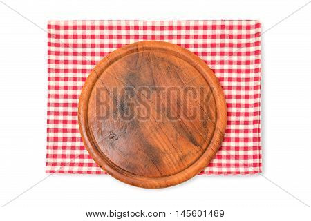 Round wooden board with checked tablecloth isolated on white background