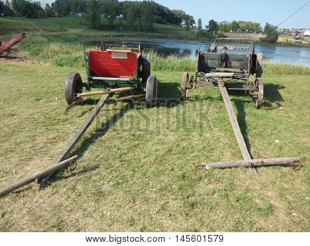 Two old horse drawn manure spreaders used in the horse and buggy days.