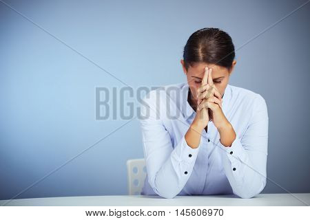 Brown Haired Office Woman Sitting Is Having Headache