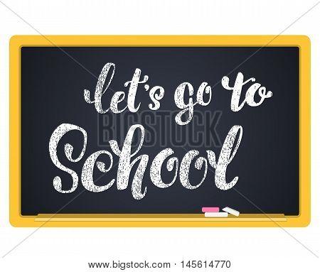 let's go school. Hand lettering inscription in chalk on a blackboard