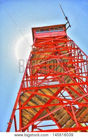 One of the original Fire Towers in the Ohio State Park System from the early 1900's. The sun is reflecting off the hundreds of flying cicadas to give the sparkles in the sky.