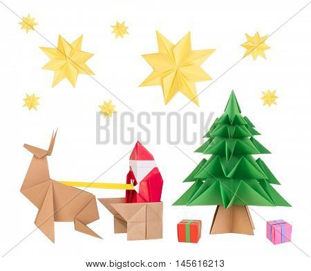 Origami santa clause, deer, Christmas tree and stars isolated on white background