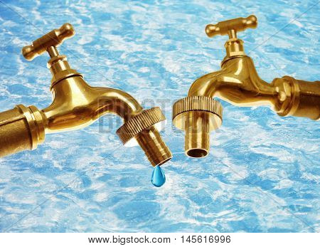 Conservation water concept. Faucets with drop on blue water surface background.