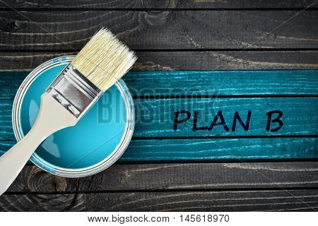 Plan B message and paintbrush on wooden table