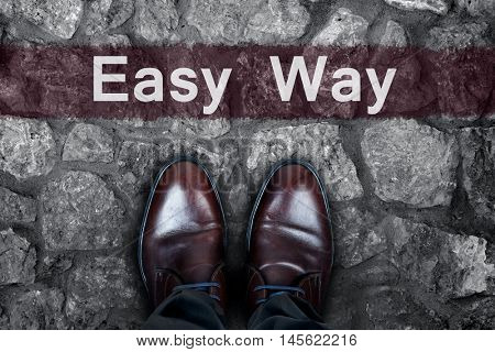 Easy Way message on asphalt and business shoes