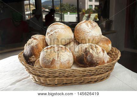 Freshly Baked Bread rolls in a natural fiber basket