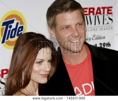 Doug Savant and Laura Leighton at the 'Desperate Housewives: Season 2 - Extra Juicy Edition' DVD Launch Event held at the Universal Studios in Universal City, USA on August 5, 2006.