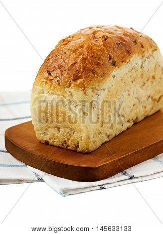 Organic flax bread with seeds on a kitchen board. Healthy and natural food. Isolated on white.