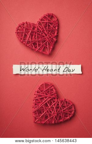 World Heart Day concept top view on red background.