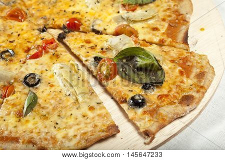 Cut into slices vegetarian pizza ready to serve