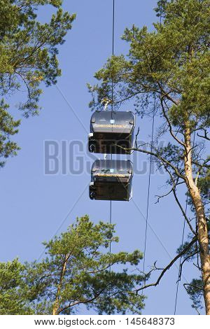 Druskininkai, Lithuania - August 28, 2016: Cableway. This is eco-friendly transport solution. The route connects Aqua Park and Snow Arena in Druskininkai. From the hight of 45 metres it is also serve as a great place for panoramic views of Druskininkai.