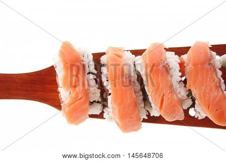 sushi onigiri inside out californian rolls on wooden paddle isolated on white background
