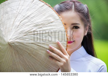 Portrait of laos girls Vietnam traditional dress famous traditional costume for woman in VIetnam.