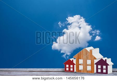 Home Model On Blue Sky With Could Background. Real Estate Concept.