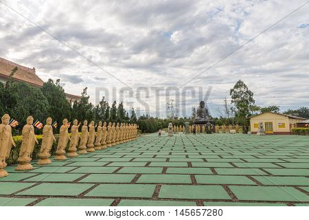 Many Buddha Statues In Perspective At The Buddhist Temple