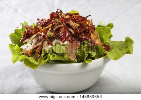 Lettuce salad prosciutto goat cheese and dried tomatoes