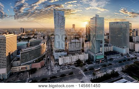 Warsaw city with modern skyscraper at sunset Poland