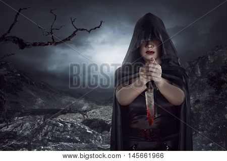 Asian Woman Holding Knife Cofered Blood