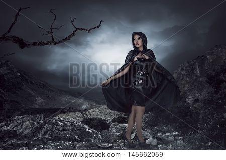 Asian Woman Wearing Black Costume