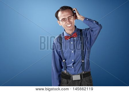 Nerdy Business Man Confused With Blue Background