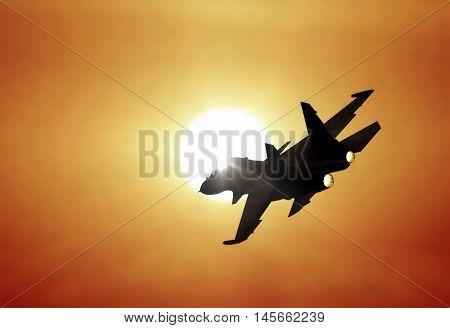 Image of jet fighter flying under sunset