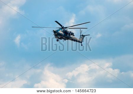 """Russian Air Force Mi-28 """"Havoc"""" attack helicopter climbing out of the Kubinka airbase to training flight for the Great Victory Day military parade poster"""