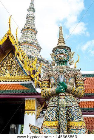 Looking Up At Giant Statue At Grand Palace, Temple Of The Emerald Buddha (wat Pra Kaew) In Bangkok ,