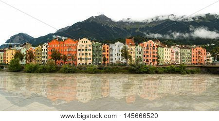 Panorama of Innsbruck, Austria, with houses reflected on water