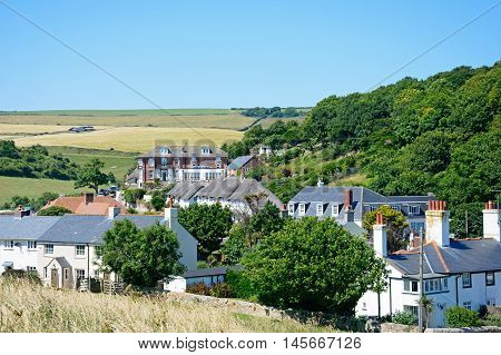 LULWORTH COVE, UNITED KINGDOM - JULY 19, 2016 - Elevated view of village cottages and houses Lulworth Cove Dorset England UK Western Europe, July 19, 2016.