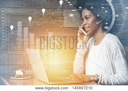 Visual Effects. Attractive Dark-skinned Female Marketing Expert Using Laptop For Distant Work At Caf
