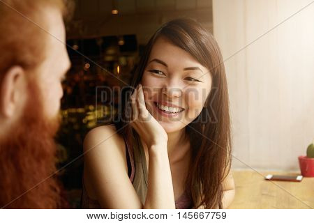 Close Up Portrait Of Good-looking Brunette Asian Female Journalist Having Interview With Popular Mal