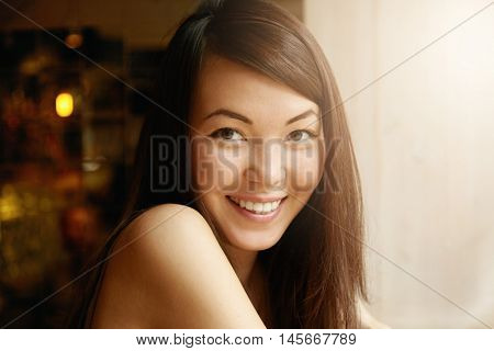 Human Emotions And Feelings. Close Up Shot Of Gorgeous Asian Female Student Smiling At Camera Showin