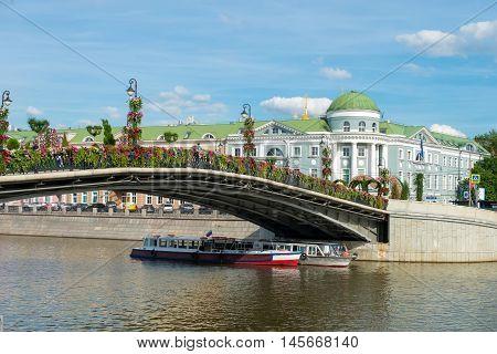 MOSCOW - JUNE 10 2016:Luzhkov bridge. One of the pedestrian bridges over the Drainage channel. It connects Bolotnaya Square with Kadashevsky embankment. Popular landmark.