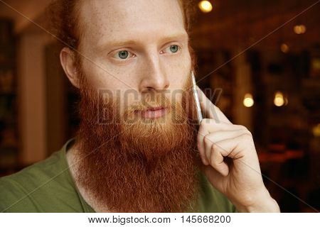 Headshot Of Sad And Upset Man Calling His Girlfriend To Tell Her That He Is Late. Handsome Guy Speak