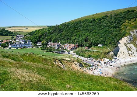 LULWORTH COVE, UNITED KINGDOM - JULY 19, 2016 - Elevated view of the beach and town surrounded by countryside Lulworth Cove Dorset England UK Western Europe, July 19, 2016.