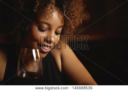 Close Up Shot Of Black Girl With Afro Hairstyle And Healthy Shiny Skin Sitting At Bar, Drinking Red