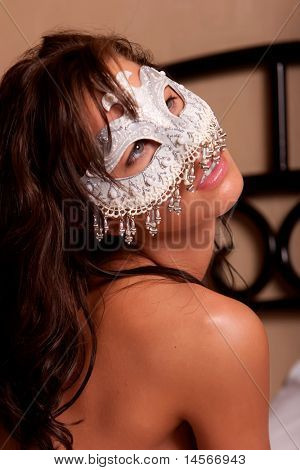 Sexy woman in white mask