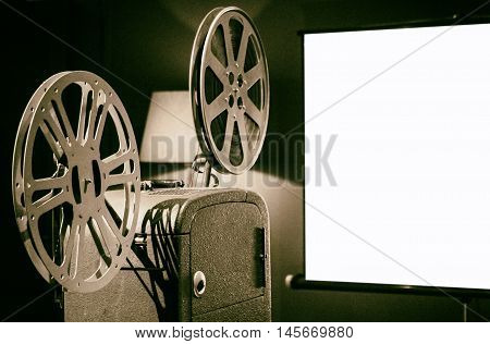 Retro film maker on the set in front of a white screen