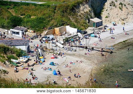LULWORTH COVE, UNITED KINGDOM - JULY 19, 2016 - Elevated view holidaymakers on the beach Lulworth Cove Dorset England UK Western Europe, July 19, 2016.