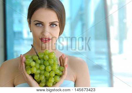 Girl Holding Grapes In Front Of Chest