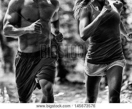 Cross fit athleteic couple jogging, black and white image