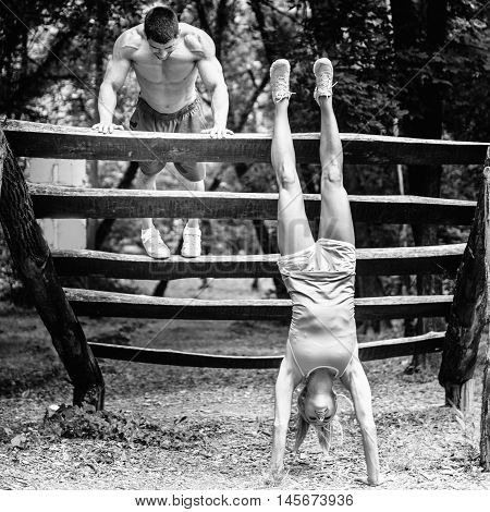 Crossfit Couple Exercising In Park