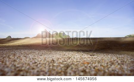 Blurred A Lot Of Broken Small Corals, Scrap Of Sea Shell On The Sand On Foreground Of Blue Sky And M