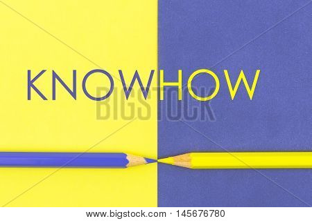 Knowhow Concept With Yellow And Violet Coloured Pencils And Paper.