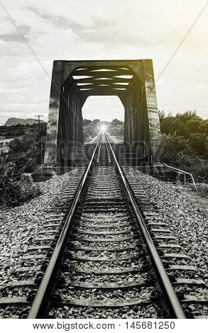 view of the length of railway and old steel bridge,filtered image, light effect added,selective focus,mean