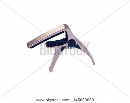 Guitar gold capo on white background close up