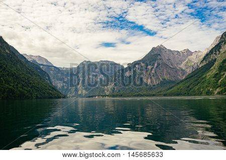 Lake Konigssee against scenic cloudscape Berchtesgadener Land Bavaria Germany